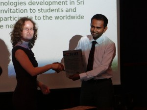 Dr.Malitha Wijesundara, Dean , Faculty of Computing receives the Plaque from Anne Ghisla, OSGeo Asia representatiove
